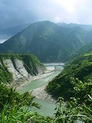 A picture of river surrounded by high cliffs