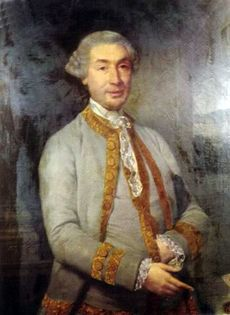 Half-length portrait of a wigged middle-aged man with a well-to-do jacket. His left hand is tucked inside his waistcoat.